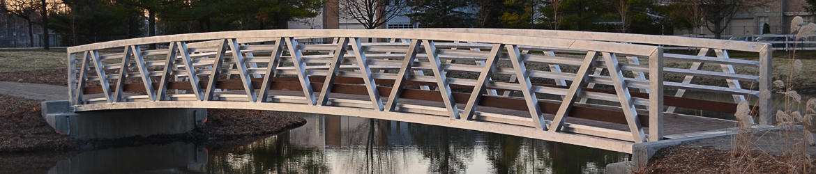 Arched Aluminum Pony Truss Pedestrian Bridge - MAADI Group, Inc.